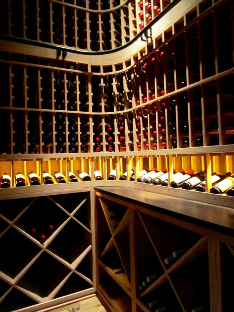 Wooden wine racks installed in a home wine cellar by Las Vegas Builders