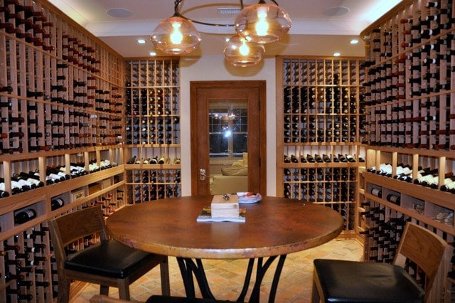 Home Wine Cellar Installed with Custom Wine Cellar Racks and an Efficient Wine Cooling System