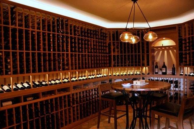 Dramatic Wine Cellar Lighting and Traditional Custom Wine Racks Presidio heights